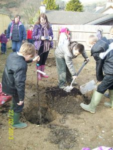 Village children planting trees